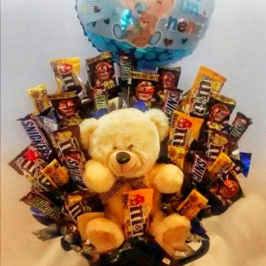 Peluche con chocolates