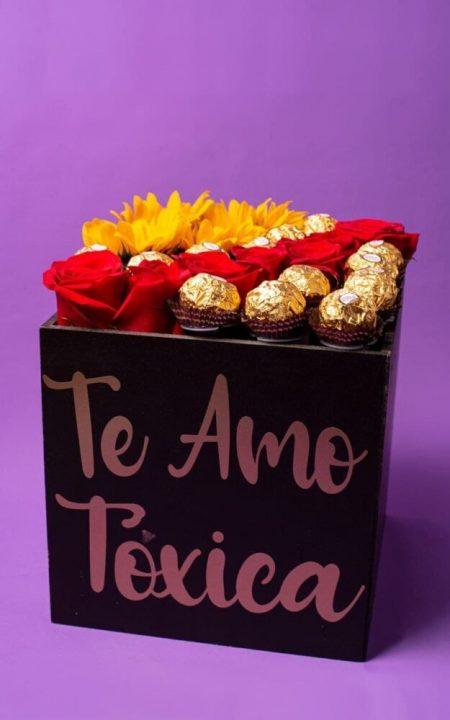 caja con rosas girasoles y ferrero
